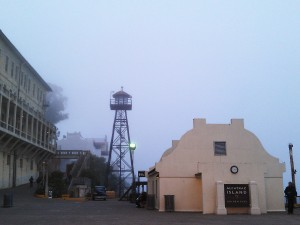 Barracks and guard tower in fog