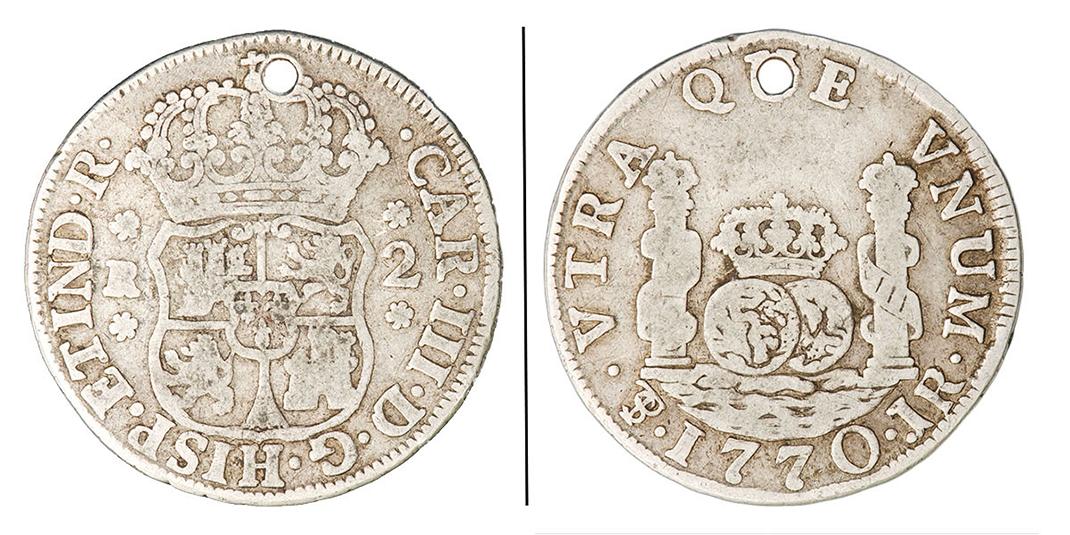 Pièce de monnaie percée d'un trou