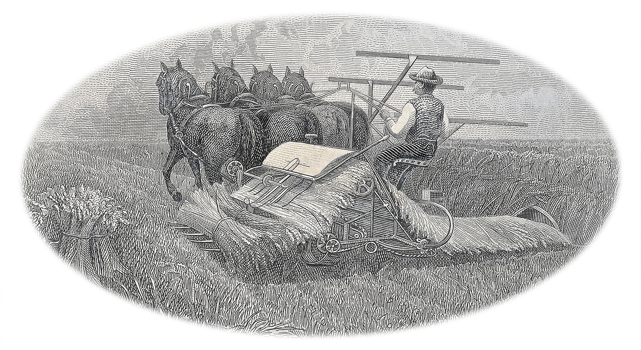 cliché représentant une moissonneuse tirée par des chevaux