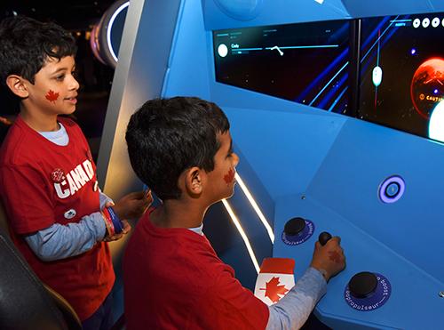 enfants jouant à un jeu vidéo