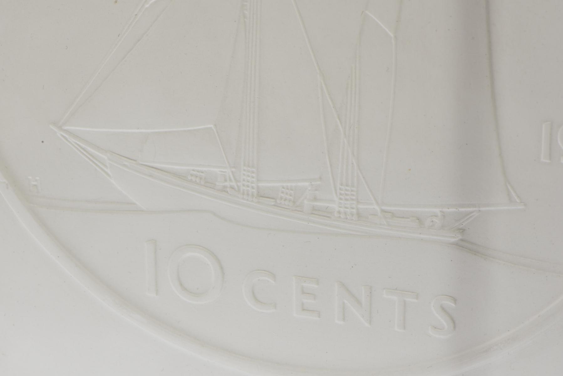 moulage en plâtre d'une pièce canadienne de 10 cents