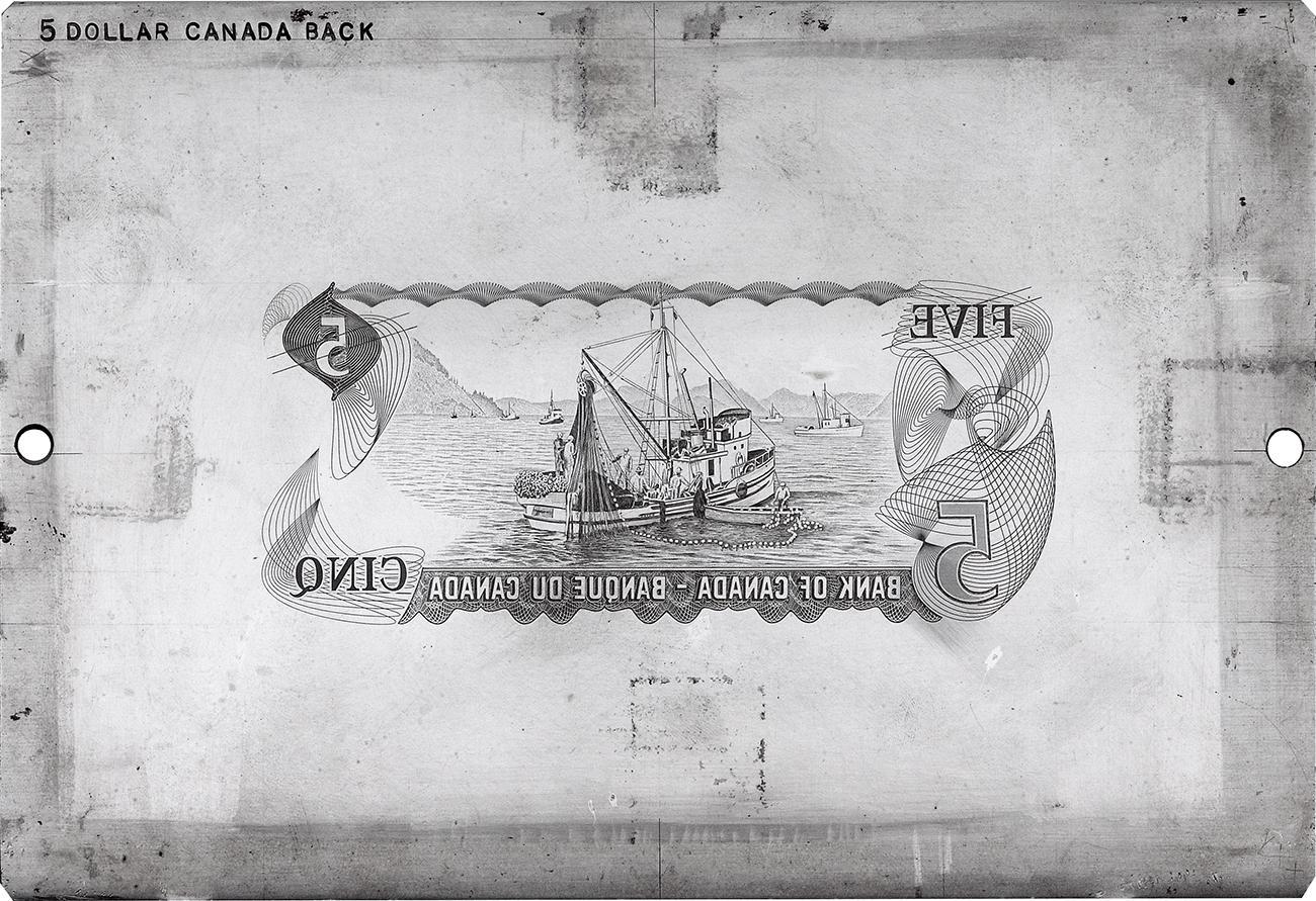 gravure d'un bateau de pêche sur une plaque matrice