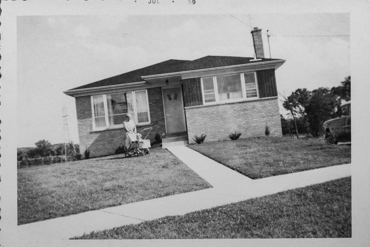 Black and white photograph of a 1950s suburban house.