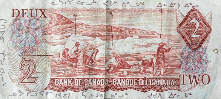 Billet de 2$ orné d'une scène de chasse inuite et portant le nom de chaque chasseur en inuktitut.