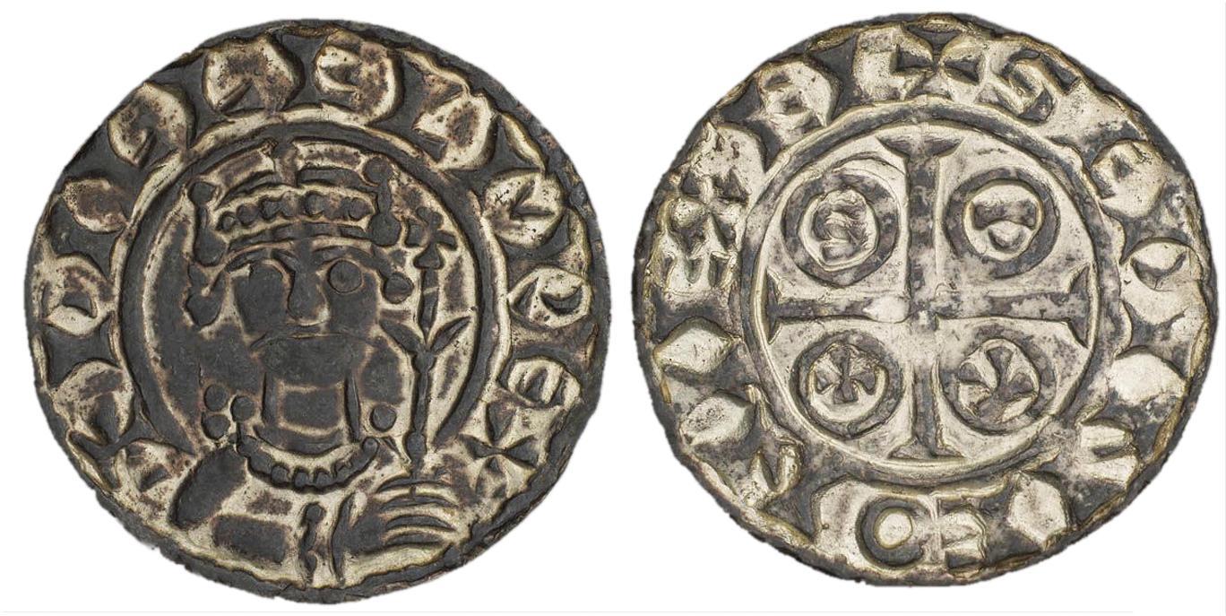 Pièce ornée de l'image d'un roi portant la moustache et tenant un sceptre.