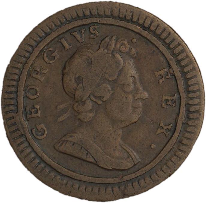 Pièce de cuivre montrant le profil d'un roi portant une couronne de laurier dans les cheveux.