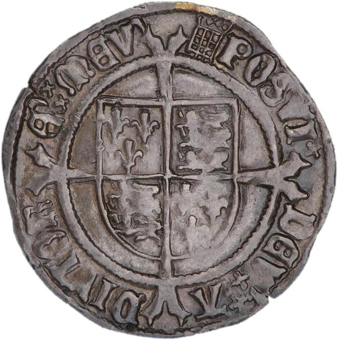 Pièce d'argent frappée grossièrement montrant une croix sur un bouclier.