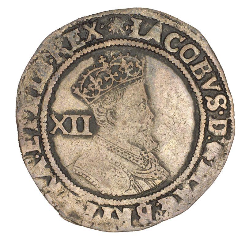 Pièce d'argent frappée grossièrement montrant le profil de la reine Elizabeth I coiffée d'une couronne.