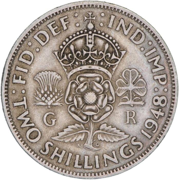 Pièce d'argent sur laquelle figure une couronne surmontant une rose anglaise, un chardon écossais et un trèfle irlandais.