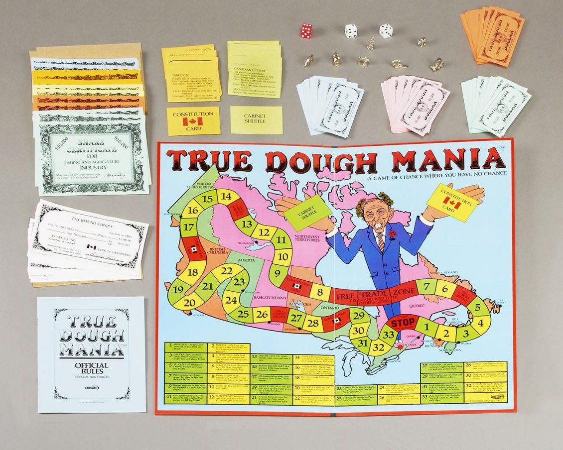 Un jeu de société illustré d'un premier ministre dessiné et d'un parcours coloré sur une carte du Canada.