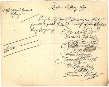 Document jauni marqué d'une écriture manuscrite fluide et bouclée.