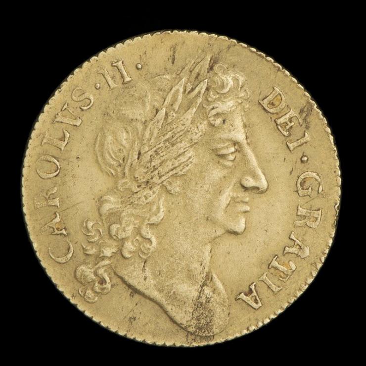 Pièce d'or montrant le profil droit d'un homme entouré de texte en latin