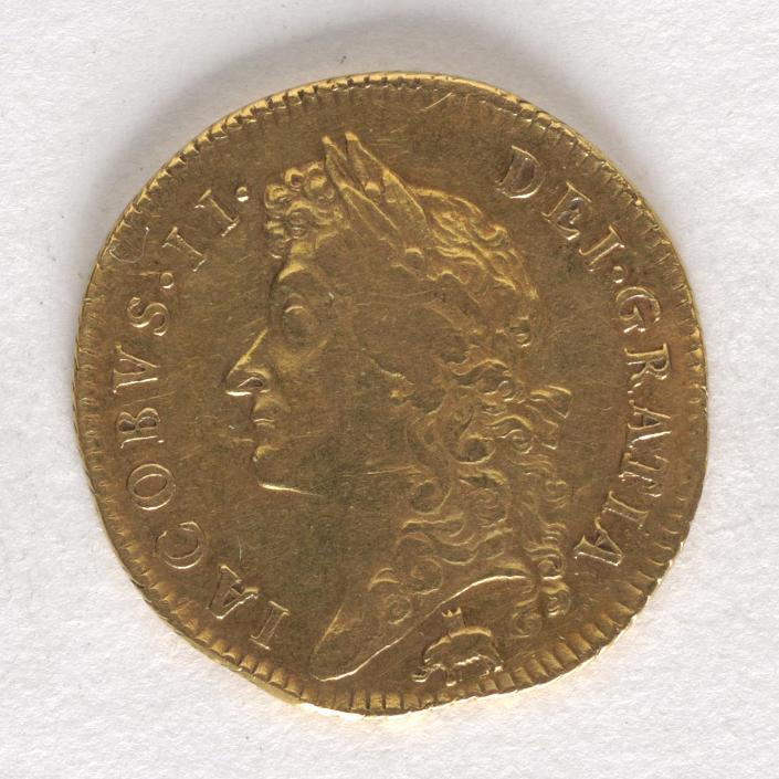 Pièce d'or montrant le profil gauche d'un homme avec en dessous un petit éléphant et un château