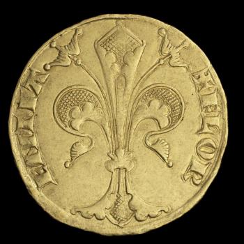 Pièce d'or montrant une fleur de lys entourée de texte en latin